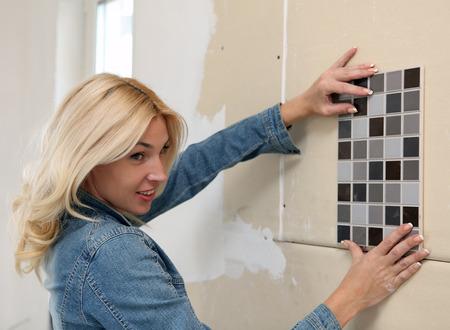 designer placing tile on a wall